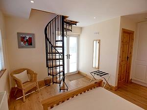 Stairs to upper bedroom